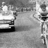 1957 – Giro d'Italia and Nencini on the attack, followed by Chlorodont team car. Ernesto Colnago is standing at upper left, behing Tano